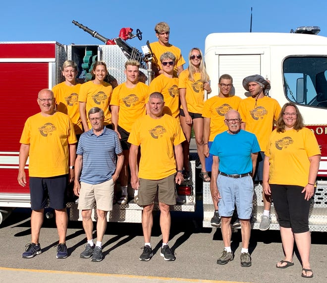 The Crookston track and field team's state-bound athletes received a police and fire department escort before they made the trip to St. Michael Thursday morning.