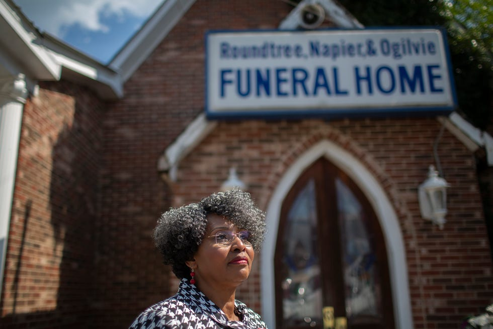 Yvonne Ogilvie, proprietor of Roundtree, Napier & Ogilvie Funeral Home and pastor of 8th & Woodland Original Church of God, stands outside the building that's home to both institutions on East 8th Street in Columbia, Tenn., on Thursday, June 17, 2021.