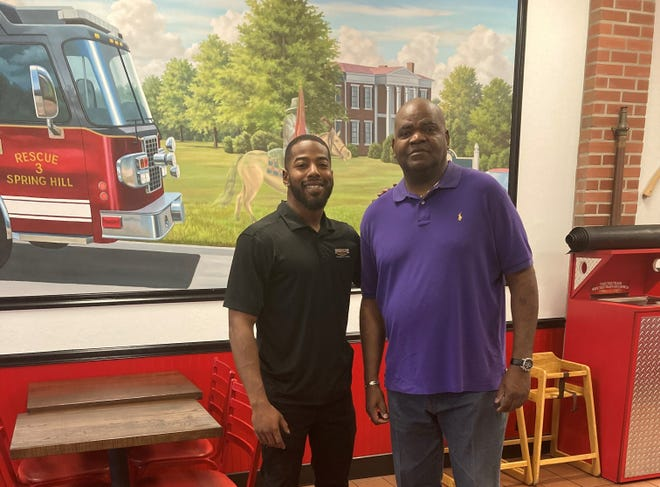 Firehouse Subs franchisee Eddie Byrd, right, operates the restaurant's Spring Hill and Columbia locations with his three sons, including Jaylen Byrd who is training to become General Manager.