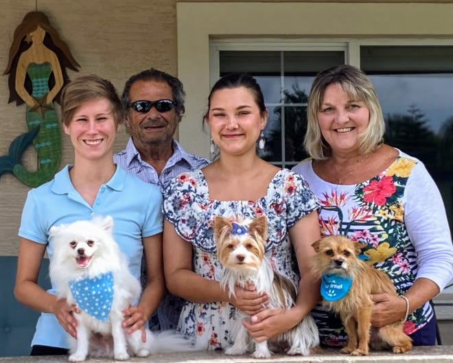 Nanette McKeel Petrella (right) and her family, who moved to Daytona Beach in 2017, have three dogs of their own, Mac, Delilah and Samson (L-R).