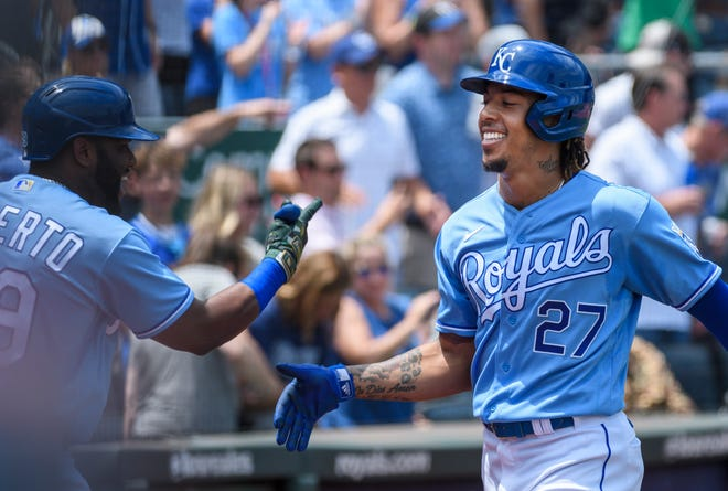 Kansas City Royals shortstop Aldaberto Mondesi (27) is congratulated by teammate Hanser Alberto after hitting a home run against the Detroit Tigers in the second inning of Wednesday's game at Kauffman Stadium. Mondesi homered in his first-at back from the injured list but the Royals couldn't hold a 3-1 lead and fell 6-5 for their sixth straight loss.