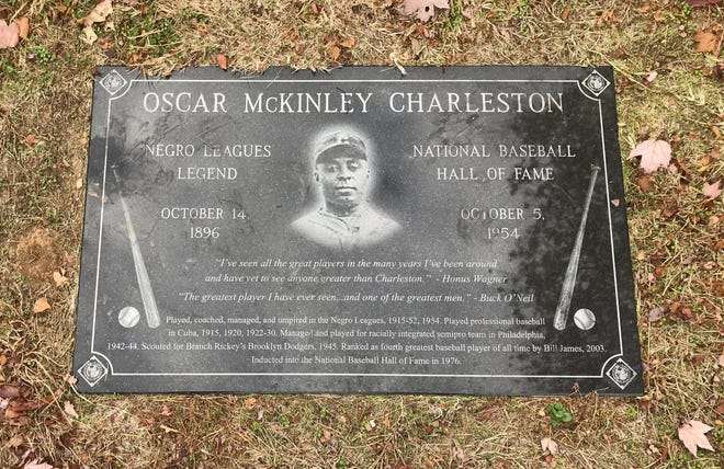 Negro Leagues players like Oscar Charleston, seen here on his tombstone, will be ranked along with greats like Babe Ruth and Ty Cobb after Major League Baseball's decision to recognize the Negro Leagues as major leagues.