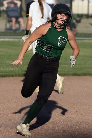 West Burlington-Notre Dame's Reagan Engberg (22) races towards third on her way to scoring during their game against Louisa-Muscatine High School Wednesday June 16, 2021 at West Burlington's Barb Carter Field.