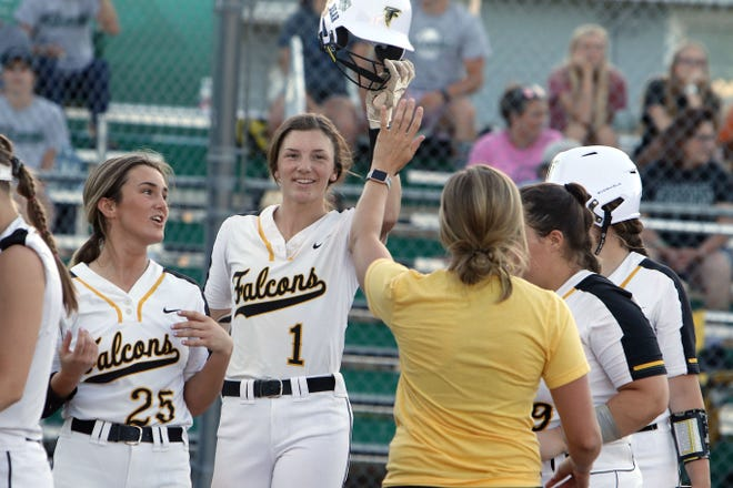 West Burlington-Notre Dame's Kylee Sanders (1) is congratulated by teammates and coaches after hitting a two run homer during their game against Louisa-Muscatine High School Wednesday June 16, 2021 at West Burlington's Barb Carter Field.