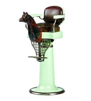 To help calm children getting a first haircut, barbers ordered special chairs with added seats shaped like animals. The Emil Paidar Company made this chair in the early 20th century. It was a feature that added value to the Cowan chair at auction. It sold for $1,375, just a few bids from the low estimate.