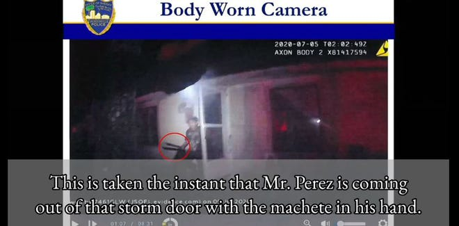 A police bodycam shows 17-year-old Axal Perez coming out of a door with a machete as an officer orders him to drop it before fatally shooting him last July 4 on Monroe Smith Road.
