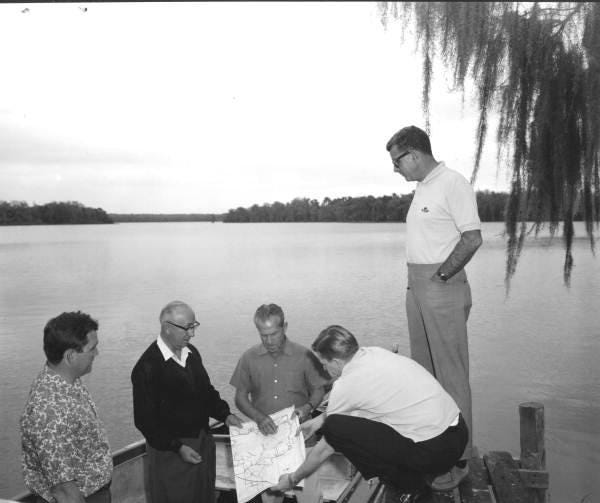 Roy Disney, second from left, and others during a property inspection for Disney World in Lake Buena Vista between 1963 and 1965.