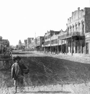 This picture from circa the 1870s looking west on Bay Street from Newnan Street is typical of photographs taken post-Civil War.