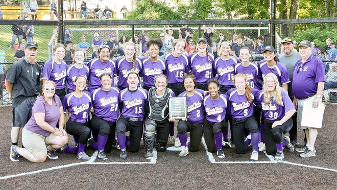The Monty Tech softball team celebrates its CMADA Division 2 championship following the Bulldogs' 10-9 victory over Blackstone Valley Tech, Wednesday, at Marlborough High School.