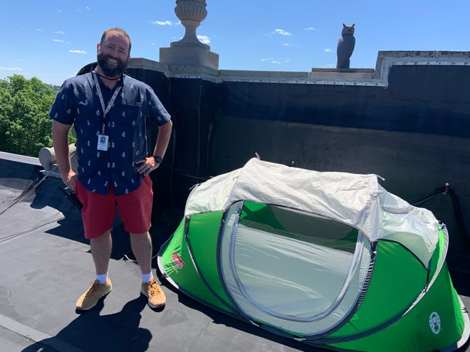 """Principal David Fredette recently spent a night sleeping on the roof of Elm Street School after """"losing"""" a wager with his students."""