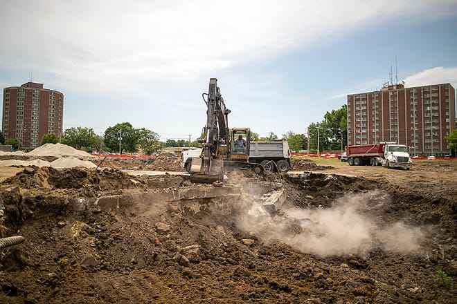 Tim Neidig with Neidig Trucking & Excavating of Canton prepares to move dirt to a waiting truck as work continues at the site of the new Galesburg Public Library on West Main Street Thursday, June 17, 2021.