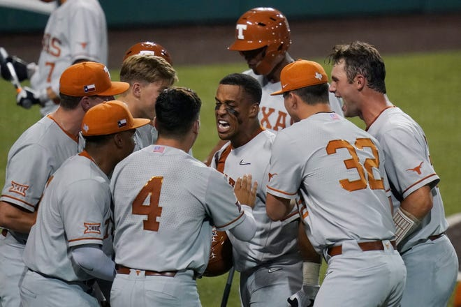 Texas' Camryn Williams, center, celebrates a two-run homer against South Florida during the seventh inning of an NCAA Super Regional game on Sunday in Austin.