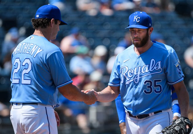Kansas City Royals pitcher Greg Holland gives the ball to manager Mike Matheny and leaves the mound during the seventh inning against the Detroit Tigers on Wednesday in Kansas City, Mo.