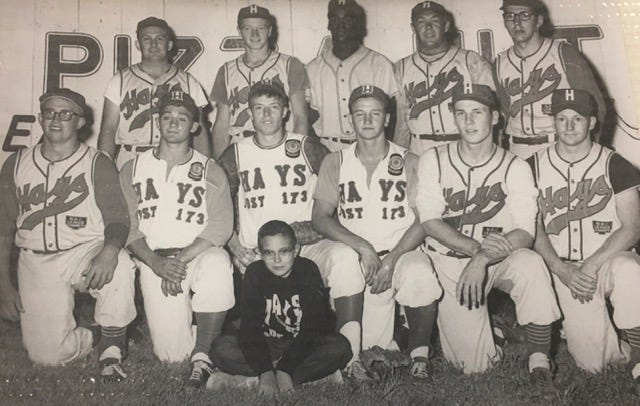 On the right end of the second row of this team photo is player-manager Arlen Walters.