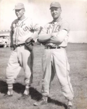 Arlen Walters, left, is with Hays Larks teammate Clair Dome before a game in Victoria.