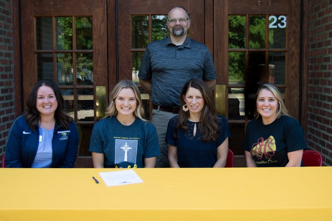 (From left to right): Coach Jessica Dowling, Reading Senior Claire Wortz, Claire Wortz's parents Jennifer and Nate Wortz, Reading Cheer Coach Amanda Hamilton.
