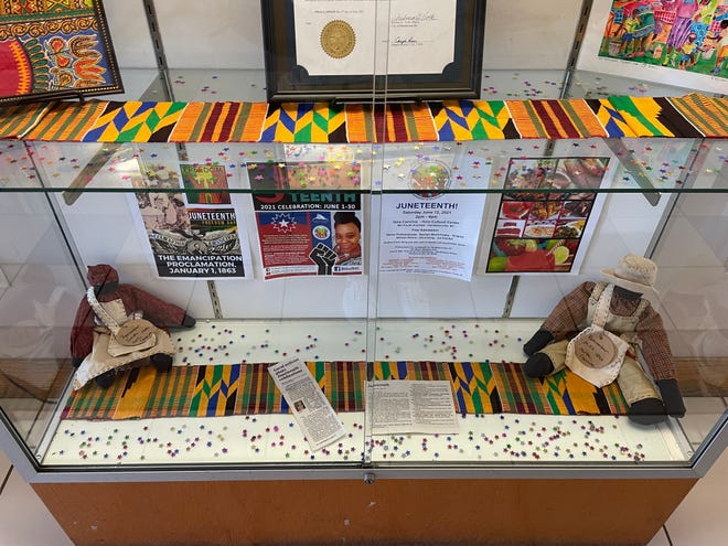 Juneteenth: Celebrating 156 Years of Freedom by Crystal Cauley will be displayed in the lobby of the Henderson County Public Library until the end of the month.