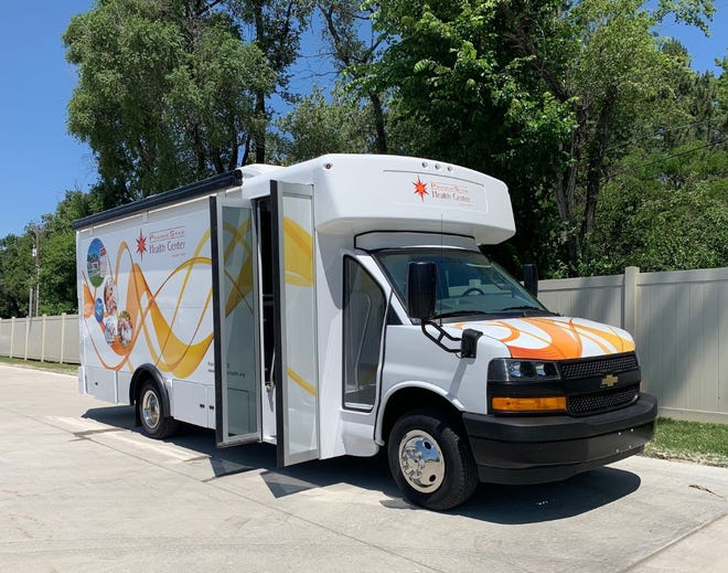 The new Mobile Medical Clinic parked in PrairieStar Health Center's parking lot.