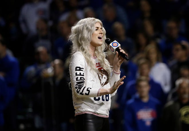 Chicago Cubs' Ben Zobrist's wife Julianna Zobrist performs the national anthem before Game 4 of baseball's National League Championship Series between the Chicago Cubs and the Los Angeles Dodgers, Wednesday, Oct. 18, 2017, in Chicago. (AP Photo/Matt Slocum)