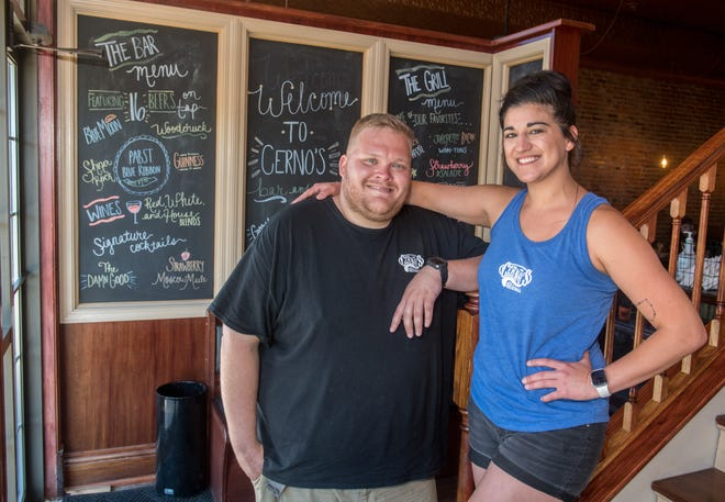 Cerno's Bar and Grill chef Justin Arrowsmith, left, and owner Casidy Tavares pose inside the popular Elmwood establishment. Recently, a group of 25 bikers who showed up with little notice were so impressed with the quality of Arrowsmith's work, they gave him a standing ovation and a big tip.