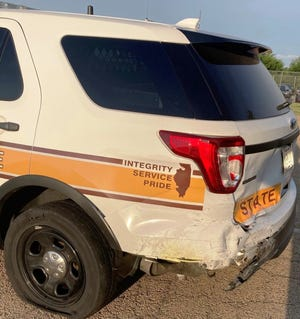 An Illinois State Police squad vehicle was rear-ended early Thursday as it was stopped along Western Avenue in Peoria.
