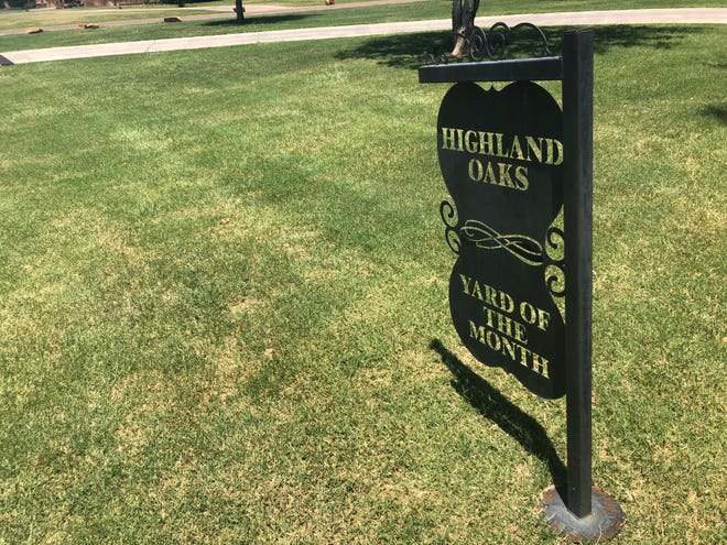 """A """"Yard of the Month"""" sign in the Highland Oaks Neighborhood in Lubbock County."""