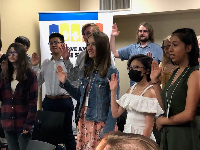 High School Students at the 2021 Preserve America Youth Summit take a Junior Ranger oath at the conclusion of Thursday morning's Town Hall event at Otero Junior College.