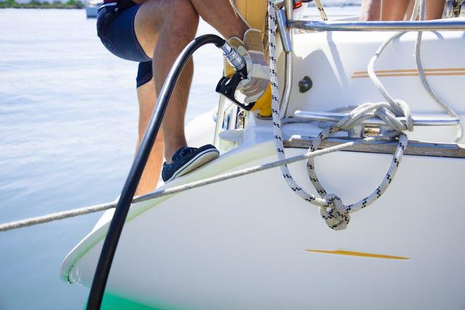 Man refueling a boat.