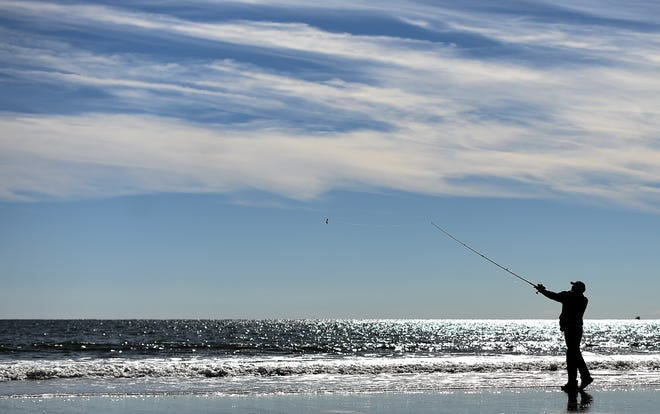 A man fishes at the beach in Atlantic City, New Jersey, on Nov. 8, 2014. (Jewel Samad/AFP/Getty Images/TNS)