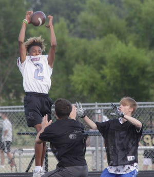 Demarcus Gilson, who will be a Moberly High School senior this upcoming school year, leaps high to grab this catch Wednesday, June 16 during a 7v7 football scrimmage held at Moberly. Such sessions are scheduled to be hosted at Moberly every Wednesday evening starting around 6 p.m.