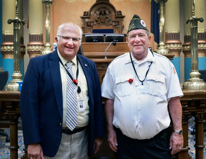 Sen. Dale Zorn, R-Ida, (left) welcomed retired U.S. Army Sgt. Samuel J. Struth of Monroe to the state Capitol as his special guest for the Michigan Senate's 26th Annual Memorial Day Service, which honored Michigan's fallen soldiers. Struth grew up in Ida and enlisted in the Army in 1975. After attending basic and advanced individual training at Fort Leonard Wood, MO and paratrooper school at Fort Benning, GA, Struth was duty stationed with 548th Engineer Battalion at Fort Bragg, NC. He served on numerous emergency relief missions, including flood cleanup in Virginia and West Virginia in 1979 and 1980 and earthquake recovery in Guatemala in 1976.