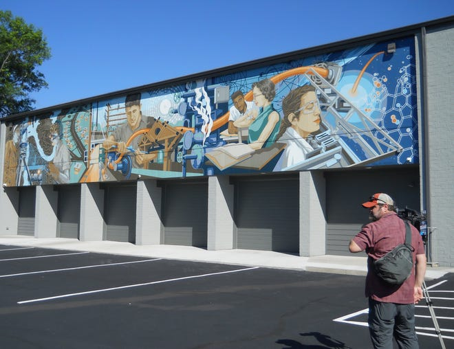 A videographer begins to capture video of the recently completed mural by Megan Lingerfelt during the morning event Tuesday, June 15, 2021.