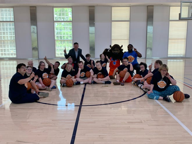 Oklahoma City Mayor David Holt, back left, and Oklahoma City Thunder mascot Rumble visited with campers during a recent basketball camp held by the Down Syndrome Association of Central Oklahoma.