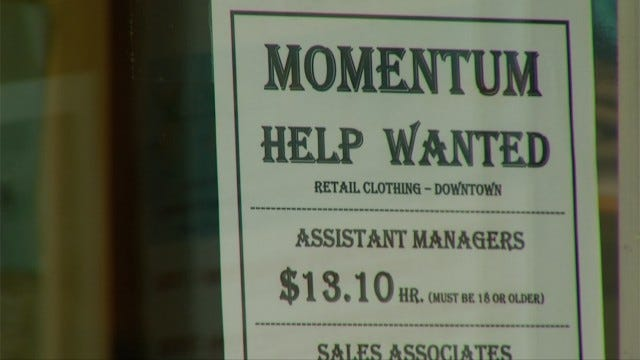 """Several Charlevoix businesses have """"help-wanted"""" signs in their front windows."""