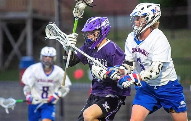 Marshwood's Andrew Goodwin, center, carries the ball through the Messalonskee defense during Wednesday's Class B boys lacrosse semifinal. Goodwin scored one goal in Marshwood's 12-4 win, sending the Hawks to their first state championship in program history.
