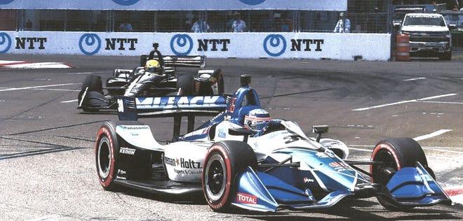 Seeman Holtz logo (side of car) on Takuma Sato's Indy car.