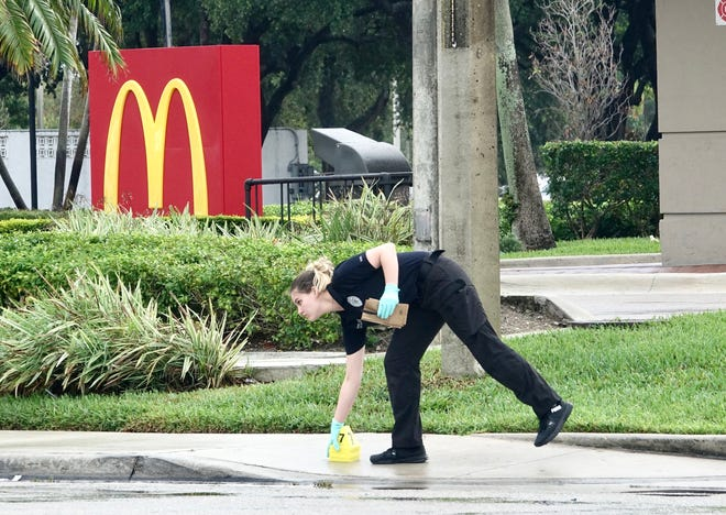 Delray Beach police investigate a fatal shooting outside the McDonald's at Linton Boulevard and Waterford Place Thursday morning, June 17, 2021.