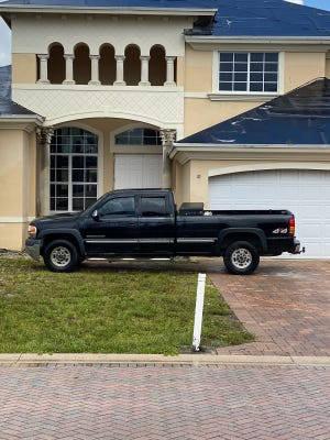 A pickup truck blocks the entrance of a home scheduled for demolition at the Estates at Boynton Waters development in Boynton Beach. The developer of the subdivision says Palm Beach County needs a court order to continue with demolitions.