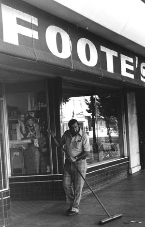 Fred Jacobs sweeps in front of Foote's, the store he owned on Pacific Avenue, in July 1972.