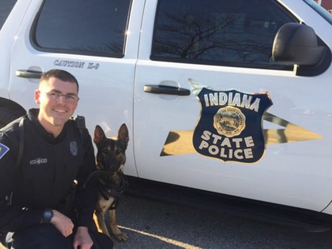 Indiana State Police Trooper Jonathan Haugh and his canine partner, Smitty.