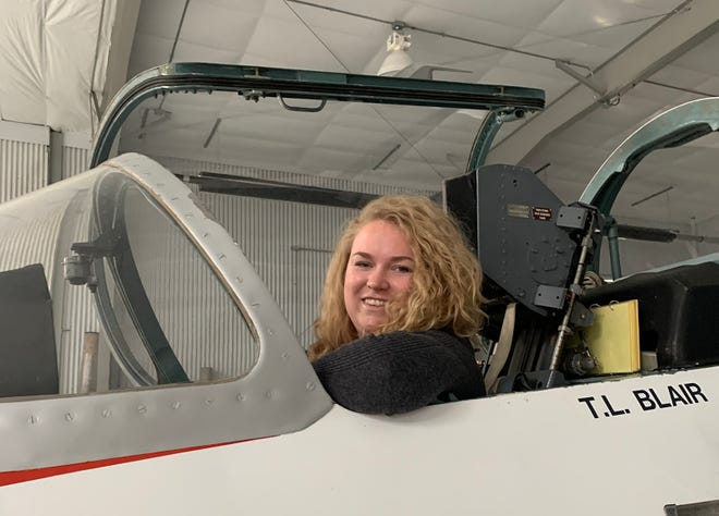 Martinsville High School graduate Katie Pratt poses for a photo while sitting in the cockpit of an airplane.