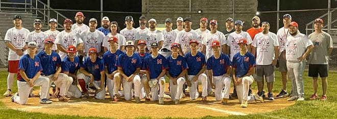 Martinsville varsity and alumni players gather for pictures to commemorate Wednesday's inaugural Artesian Baseball Alumni Game at Tutterow Field.
