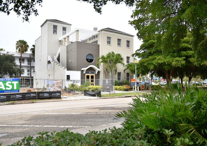 Raymond Peper and Richard Day are selling their property at 1345 Second St. in Sarasota, the John Carl Spa & Salon. The three-story building has commercial space on the first floor and residential on the second and third floors. The property is listed for $3.7 million.