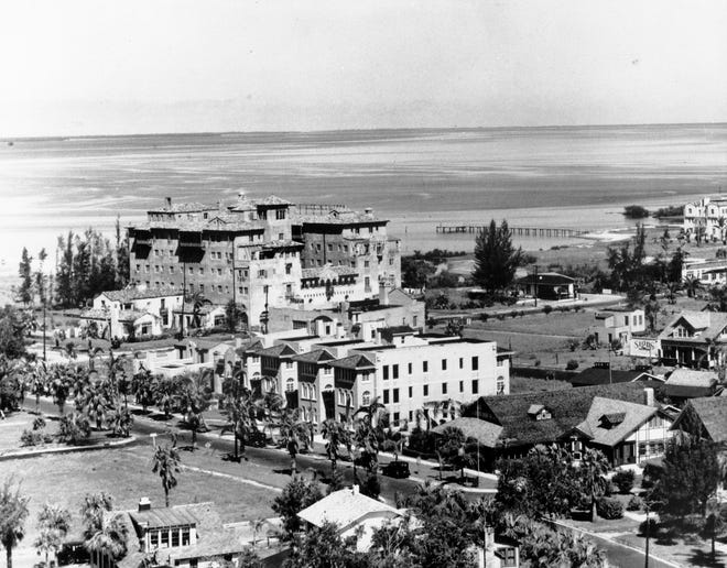 Iconic photo the Sarasota Bay front, looking from Palm Ave. before the glut of high rise buildings marred the view. The Bickel House and John Ringling Hotel were demolished in 1998. In the foreground, the Frances-Carlton Apartments have survived.