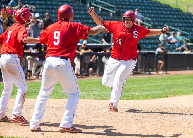 Springfield's Ryne Crum (25) crosses the plate to put the Senators up 6-4 in the eighth inning against Burbank St. Laurence during the Class 3A State Tournament semifinals Thursday at Wintrust Field in Schaumburg. [Justin L. Fowler/The State Journal-Register]