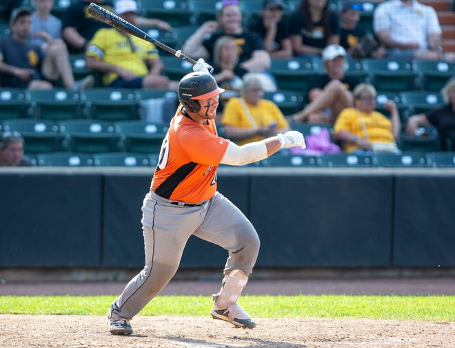 Washington's Josh Heyder (20) hits an RBI single against Burbank St. Laurence during the Class 3A state tournament third-place game at Wintrust Field in Schaumburg on Thursday.