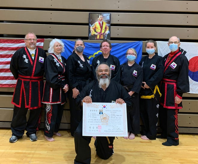 Dr. Christopher Hall was recently promoted to the rank of 3rd degree Black Belt in the Korean martial art style of Kuk Sool Won. Hall was presented with a 3rd degree black belt, an ID card and a promotion certificate. Hall, pictured in front, was joined by some of his instructors and other students who were also testing, including from left to right, back row: Ben Forejt 5th degree, Lynn Wicks 4th degree, Barbara Teeple 1st degree, Michael Bernier 1st degree, Madison Lee testing for 1st degree, Cynthia Gardner 1st degree, Karl Stolt 6th degree.