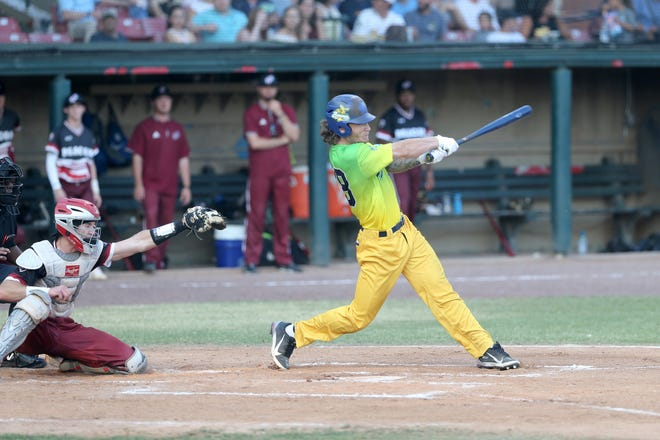 Savannah Bananas first baseman Dan Oberst connects for a hit against the Macon Bacon in the season opener May 27 at Grayson Stadium.