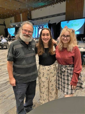 Shawnee Academic All-Stater Olivia Todd (center) is congratulated by her father Phillip Todd and sister Helena during the Oklahoma Foundation for Excellence Academic Awards Ceremony, held recently in Tulsa.