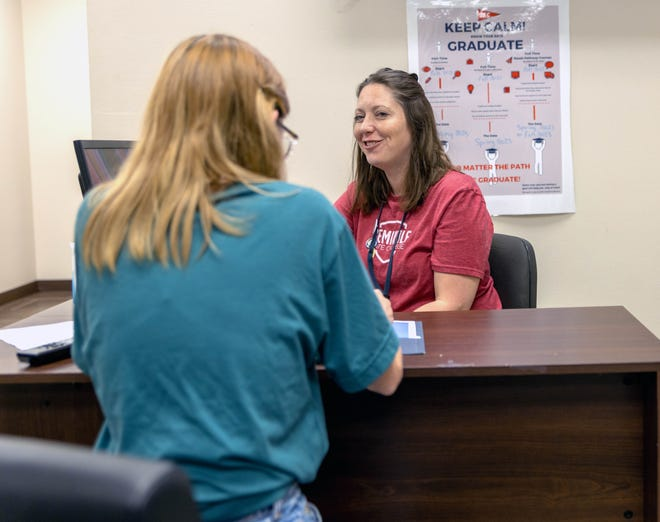 Seminole State College Recruitment Specialist Britney Honsinger helps a student enroll for the fall semester on June 17.